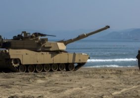 Cpl. Henry Estrada a gunner with 1st Tank Battalion from Lewisville, Texas, guides an M1A1 Abrams Main Battle Tank off the Landing Craft Air Cushion during rail operations at Dogu Beach, Republic of Korea, on March 15, 2016, as part of Exercise Ssang Yong 16. Ssang Yong 16 is a biennial combined amphibious exercise conducted by forward-deployed U.S. forces with the Republic of Korea Navy and Marine Corps, Australian Army and Royal New Zealand Army Forces in order to strengthen our interoperability and working relationships across a wide range of military operations - from disaster relief to complex expeditionary operations.